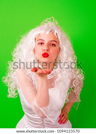 beautiful young girl with curly hairstyle. A gorgeous princess in a vintage dress and glowing white long hair. the heroine of the fairy-tale film. Air kiss.