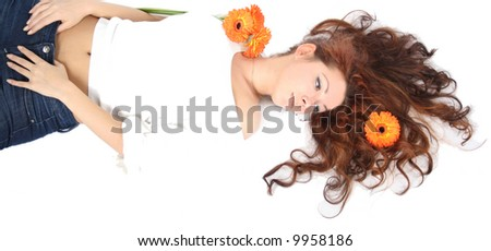 beautiful young girl with flowers is relaxing #9958186