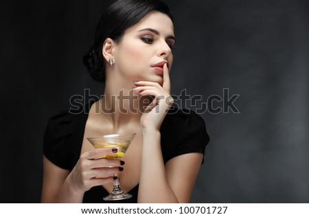 beautiful young girl  with  glass of martini