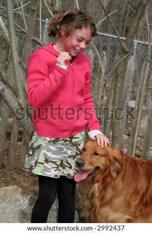 beautiful young girl with golden retriever