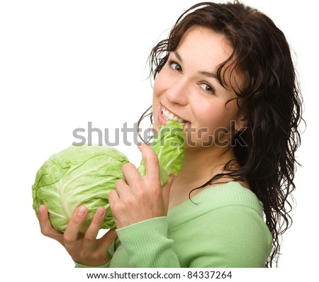 Beautiful young girl with green cabbage, isolated over white - stock photo