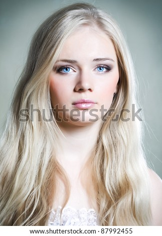 Beautiful young girl with long white hair and shiny skin