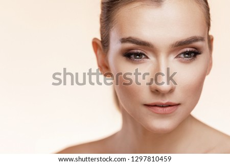 Beautiful Young Girl With Perfect Skin On Beige Background. Skin Care Concept