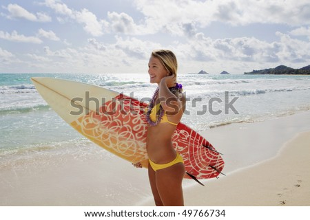 beautiful young girl with surfboard at kailua beach, hawaii