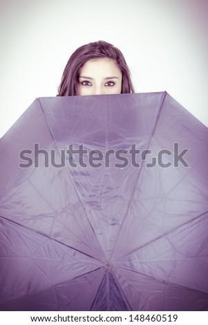 beautiful young girl with umbrella,  studio shot