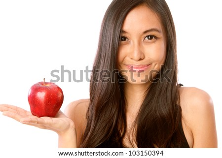 Beautiful Young Happy Caucasian / Asian Woman / Girl Holding up a Juicy Red Apple. Isolated on White Background