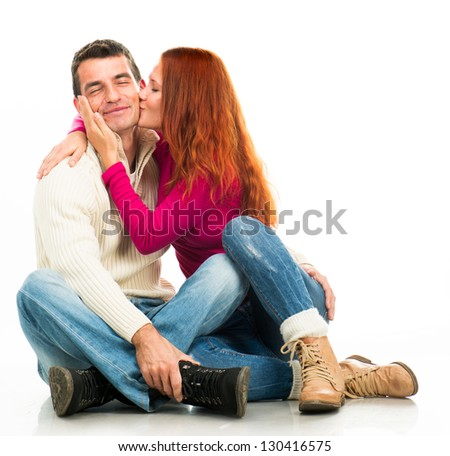 Beautiful Young happy couple kissing on white background