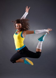 beautiful young hip hop dancer jumping in studio