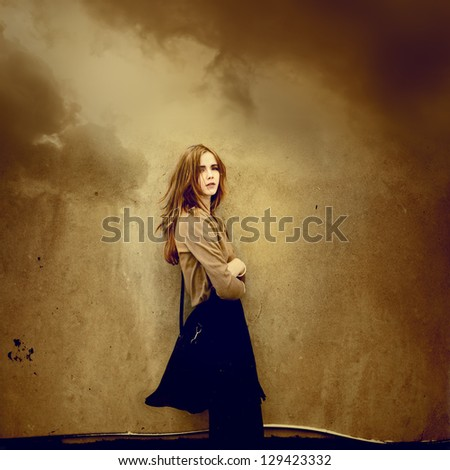Beautiful young hipster girl dreams about clouds