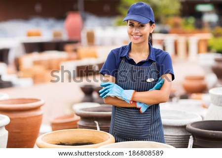 beautiful young home and garden store business owner