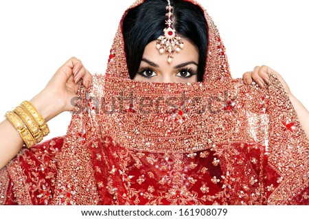 Beautiful young indian bride in traditional clothing with bridal makeup and jewelry. gorgeous brunette bride traditionally dressed. Woman bollywood dancer in Sari. Arabian bellydancer