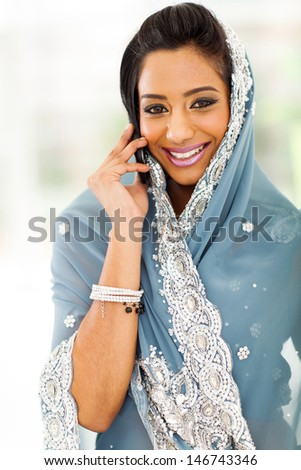 beautiful young Indian woman in traditional clothing talking on cellphone