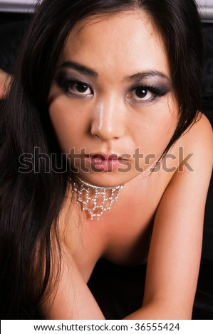 stock photo : Beautiful young Japanese woman lying nude in bed