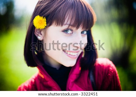 beautiful young lady outdoor smiling and flirting