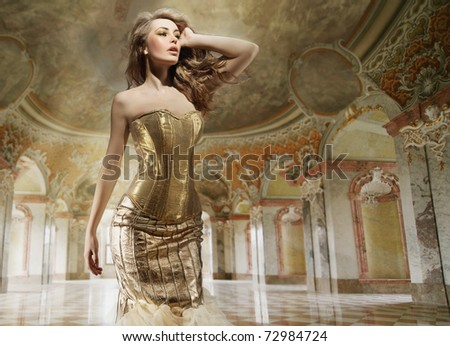 Beautiful young lady standing in a stylish interior