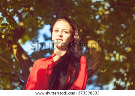Beautiful young lady walking in nature on sunny spring day. #373598533