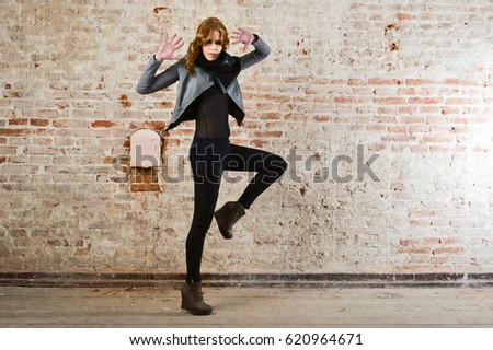 beautiful young lady wear leather jacket and pant in retro house on red bricks stone wall #620964671