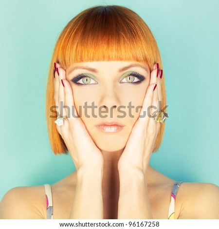 Beautiful young lady with red-haired bob