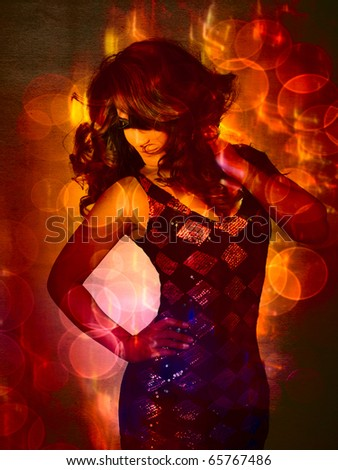 beautiful young Latin American woman in fashion sequin dress dancing with curly hair blowing on bright lights