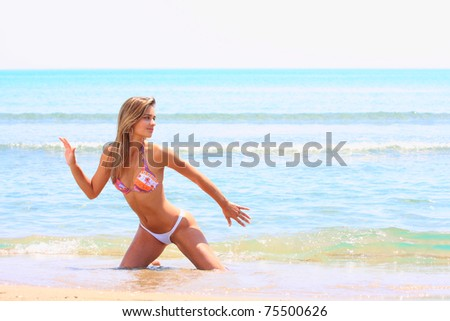 beautiful young latino woman wearing a bikini portrait on beach