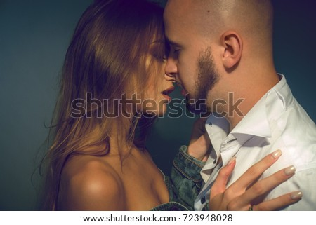 beautiful young lovely couple hugging and kissing in studio #723948028