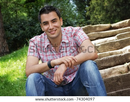 Beautiful young men sitting on stairway, outdoor -shot