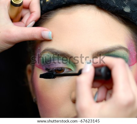 beautiful young model getting fashion make-up