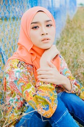 Beautiful young model in fashionable hijab style posing in burnt bush area. Stylish Muslim female hijab fashion lifestyle portraiture concept