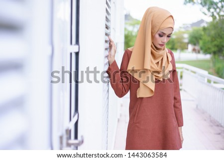 Beautiful young model in fashionable hijab style posing in urban  environments. Stylish Muslim female hijab fashion lifestyle portraiture  concept