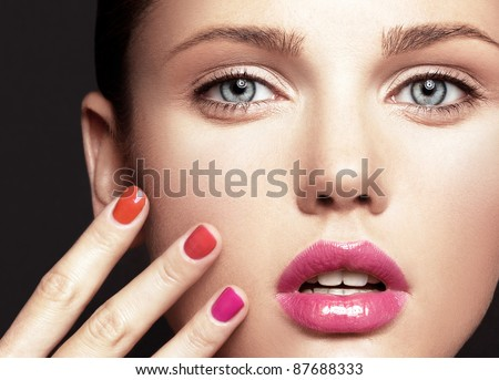 Beautiful young model with bright make-up and manicure - stock photo