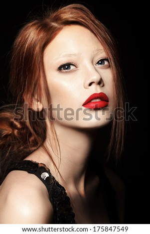 Beautiful young model woman with red lips and shine hair