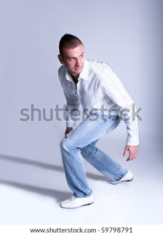 Beautiful young modern  man in  shirt  is running , studio shot - stock photo