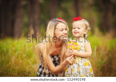 beautiful young mother and her daughter in the park