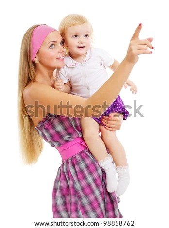 Beautiful young mother in pink dress showing something interesting to her cute little daughter. Isolated on white background, mask included