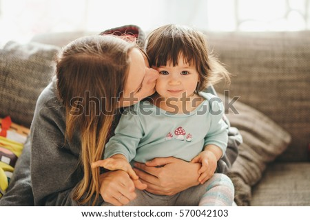 beautiful young mother with...
