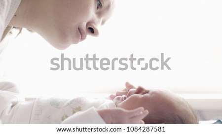 beautiful young mother with crying baby #1084287581