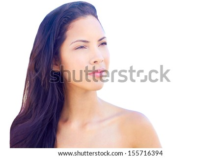 Beautiful young multi ethnic fashion model near the sea with clear skin and flowing long hair