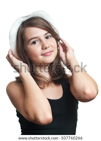 Beautiful young multicultural girl wearing a hat in a studio pose with white background.Teenage girl  at studio.