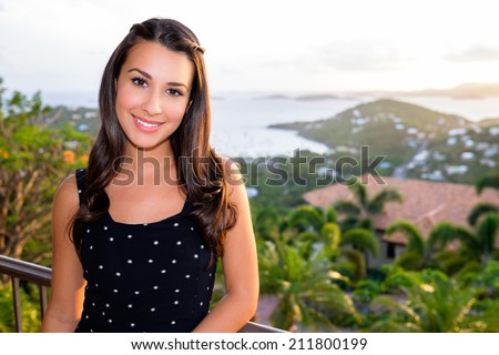 Beautiful young multicultural woman enjoying the beauty of the Caribbean in Saint John in the United States Virgin Islands.