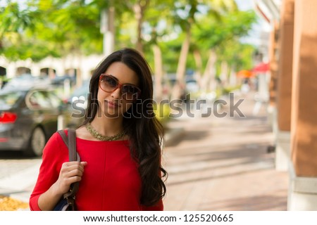 Beautiful young multicultural woman outdoor portrait.