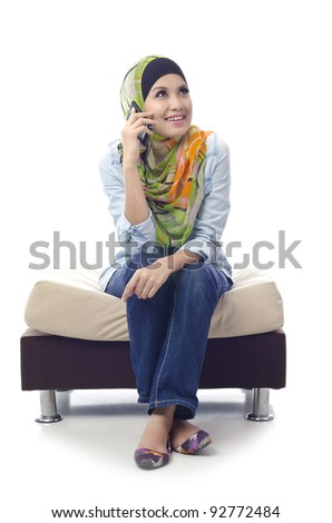 beautiful young muslim girl enjoy her conversation with friends using phone  isolated on white background