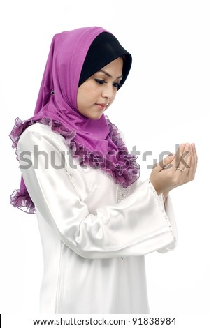 Beautiful young muslim woman pray from side view isolated white background
