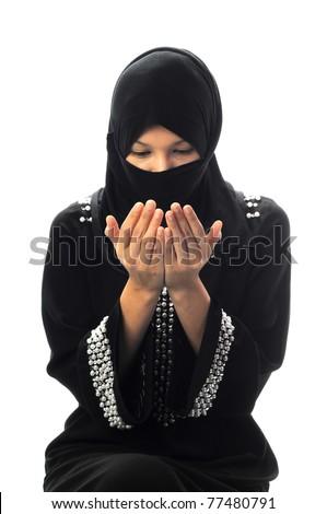 Beautiful young muslim women pray looking down
