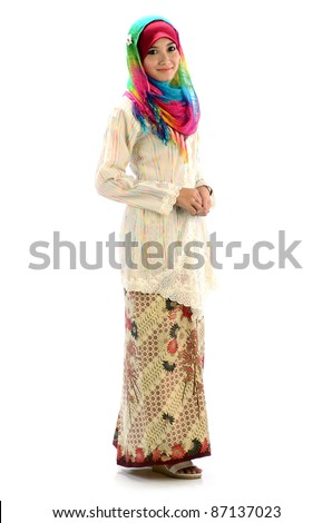 Beautiful young Muslim women with colorful scarf and traditional dress.