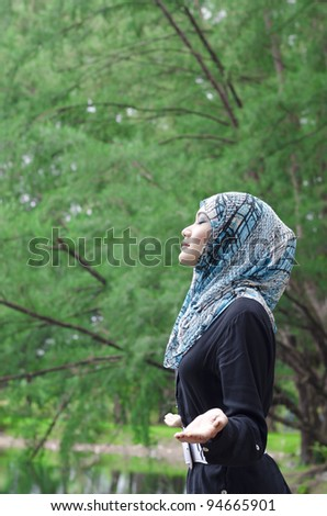 beautiful young muslimah woman with stylish appreciate the beauty of nature while breathing the fresh air