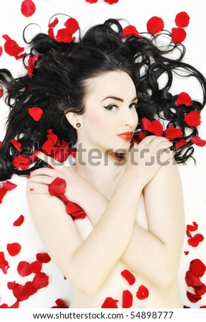 beautiful young nude woman with roses isolated on white representing beauty concept
