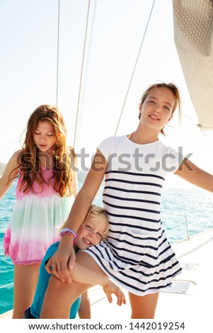 Beautiful young people enjoying luxury sailing yacht trip on summer vacation, sunny outdoors. Family coastal boating activities day out, leisure recreation lifestyle at sea travel together. #1442019254