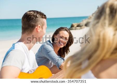 Beautiful young people with guitar having fun on beach #354707351