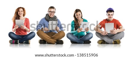 Beautiful young people with tablet in studio