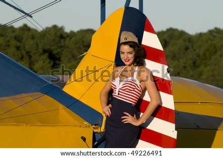 Aviation Pin Up Girls http://www.shutterstock.com/pic-49226491/stock-photo-beautiful-young-pinup-girl-posing-next-to-a-vintage-biplane-aircraft.html